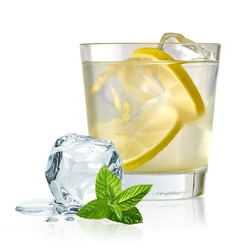 Vodka lime, gimlet or gin tonic with ice in glass on white background