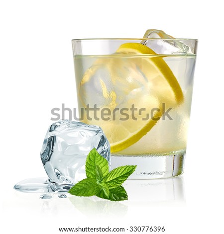 Vodka lime, gimlet or gin tonic with ice in glass on white background  #330776396