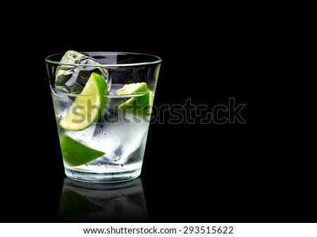 Vodka lime mojito or gin tonic  with ice in rocks glass on black background including clipping path #293515622