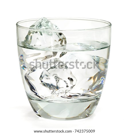 Vodka or gin in rocks glass with ice isolated on white background