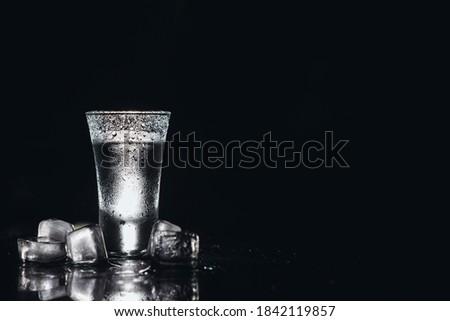 Vodka. Shots, glasses with vodka with ice .Dark background. Copy space .Selective focus Zdjęcia stock ©