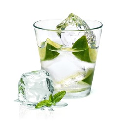 Vodka with ice and lime wedge isolated on white background