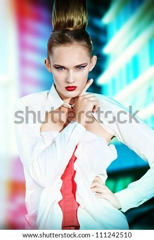 Vogue model posing over big city background.