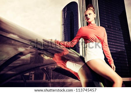 Vogue model posing over big city background.