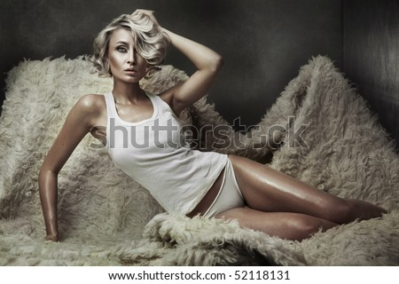 Vogue style photo of a young blond beauty