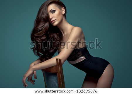Vogue style photo of very delicate brunette woman