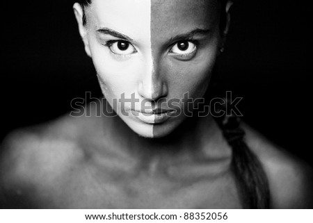 Vogue style portrait of a woman with b&w makeup. Closeup.