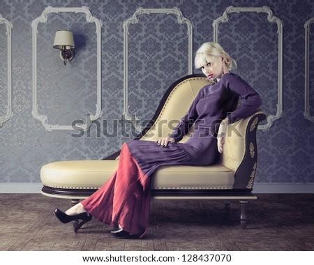 Vogue style sensual portrait of beautiful woman in dim light