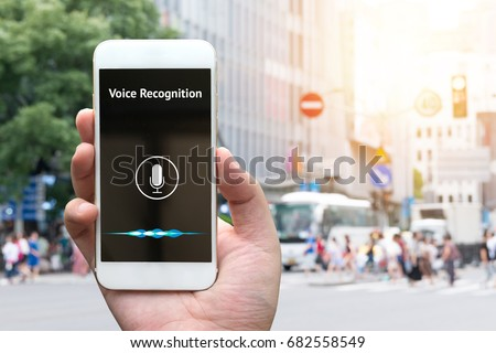 Voice recognition , speech detect and deep learning concept. Application on mobile phone screen with blur city background. #682558549