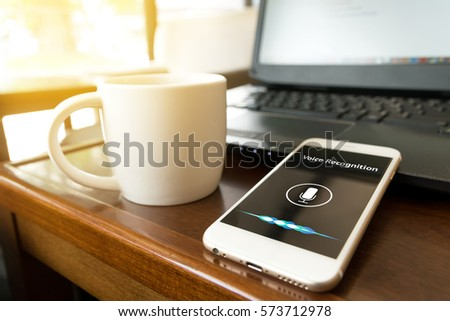 Shutterstock Voice recognition , speech detect and deep learning concept. Application on mobile phone screen in coffee shop background with flare light effect