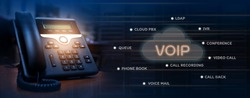 VOIP services concept of ip telephone device on work place, blurred data center with server racks, cloud icon with services words of voip