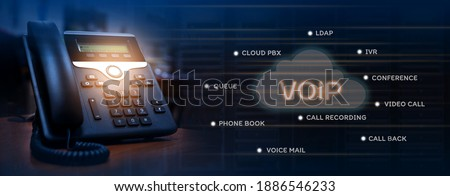 VOIP services concept of ip telephone device on work place, blurred data center with server racks, cloud icon with services words of voip Zdjęcia stock ©