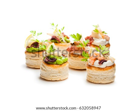 Vol-au-vents  puff pastry cases filled with salted squid and octopus  #632058947