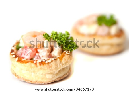 Volauvents filled with fresh shrimp salad isolated on white