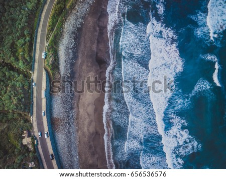 Volcanic Aerial Sunset Beach. Ocean and Aerial Ocean. Aerial Shot of Tide, Sea, Wide Dramatic Landscape View. Black Volcanic Sand Beach. Canary Island and Paradise Atoll. Aerial Background Landscape #656536576