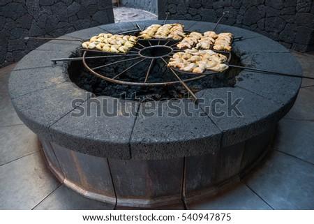 Shutterstock Volcanic barbecue in the Parque Nacional de Timanfaya, in Lanzarote, Spain