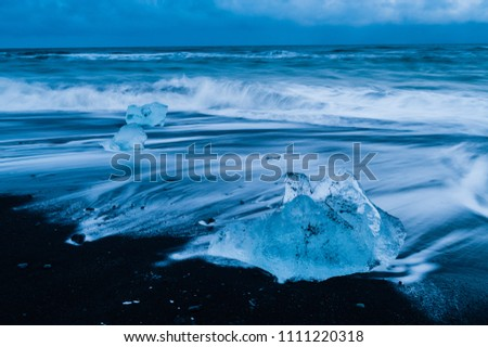 Stock Photo volcanic black sanded diamond beach ice rocks with smashing waves, iceland april 2018