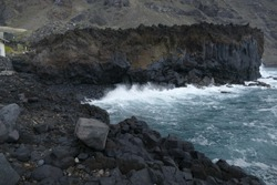 Volcanic coast landscape, waves braking against lava rocks in La Palma, Canary Islands, Spain.