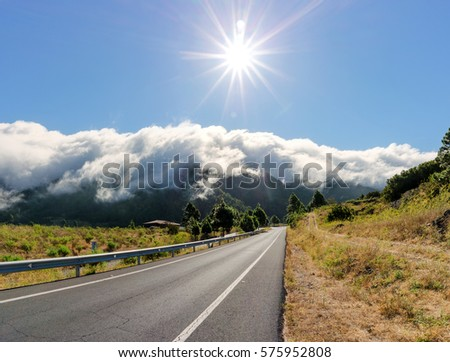 Volcanic landscape near El Pasp with road and famous cloud waterfall, La Palma, Canary Islands, Spain Stok fotoğraf ©