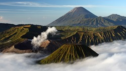 Volcanic landscape of National park Bromo Tengger Semeru in east Java, Indonesia. View from Mount Pananjakan at inactive Batok volcano, smoking crater of Bromo and Semeru in the background.
