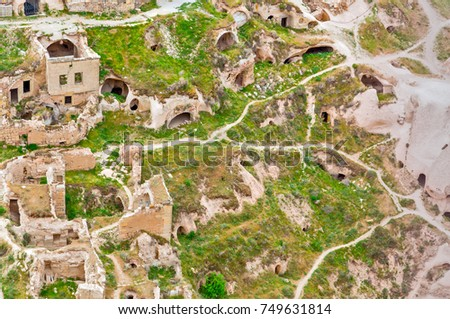 Volcanic rocks. Ancient cave town in Goreme, Cappadocia, Turkey #749631814