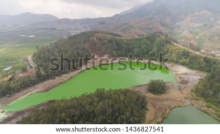 volcanic sulfur lake telaga warna in dieng plateau, java Indonesia. mountain tropical landscape lake with green water among mountains. this lake is one mainstay tourist destinations in Wonosobo
