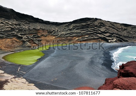 Volcano crater as black sand beach on Lanzarote