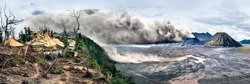 Volcano eruption and ruined village. Mount Bromo is active volcano in East Java, Indonesia. Panoramic view