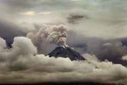 Volcano eruption of Merapi mount from Indonesia. Dark, gloomy, and cloudy.