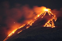 Volcano Etna erupting at night. Mount with lava and magma