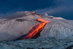 Volcano Etna Eruption - lava flow through the snow
