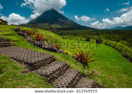 Volcano of Arenal with stone stairs on the foreground at sunny day. Costa Rica #651969919