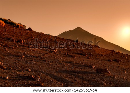 Volcano Teide, Tenerife Spain. Landscape view at sunset Surreal picture of a red desert terrain like mars surface. Mountain panorama at the golden hour with no one Tourist postcard from Canary Island