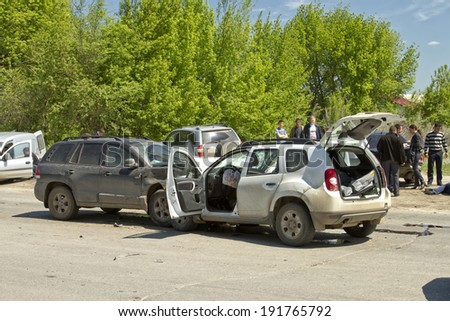 VOLGOGRAD - MAY 7: Head-on collision of two cars on the street Bamboo, accident seriously injured people. May 7, 2014 in Volgograd, Russia.