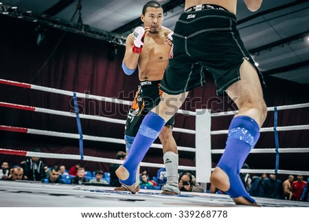 Volgograd, Russia - October 24, 2015: fighting stand-up athlete mixed martial arts during Championship of Russia on mixed martial arts