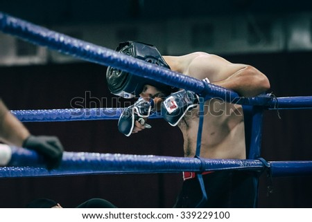 Volgograd, Russia - October 24, 2015: MMA fighter stands in corner of ring before fight during Championship of Russia on mixed martial arts