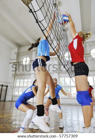 volleyball game sport with group of girls indoor in sport arena