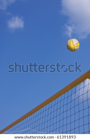 volleyball in the air over the net with copy space