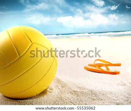 Volleyball in the sand with sandals at the beach