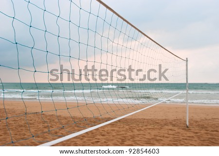 volleyball net against the beach