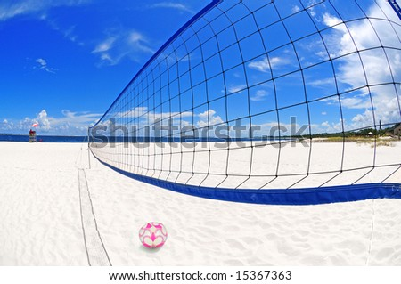Volleyball net and court on pretty white beach sand