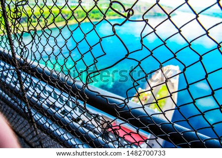 volleyball net and fishing net in fading light