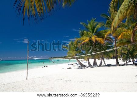 Volleyball net on caribbean beach, Saona