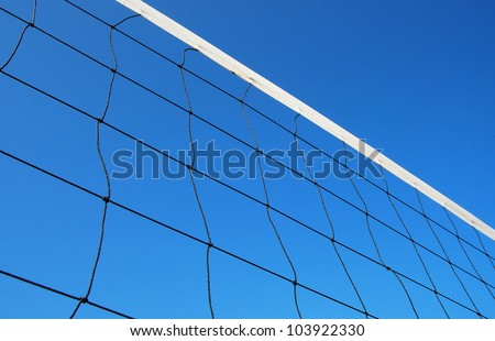 Volleyball net on the beach blue sky for background design