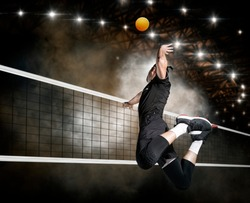 Volleyball player players in action. Sports banner. Attack concept with copy space