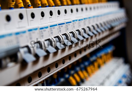 Voltage switchboard with circuit breakers. Electrical background stock photo