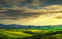 Volterra panorama, rolling hills and green fields on sunset. Rural landscape. Volterra Italy, Europe