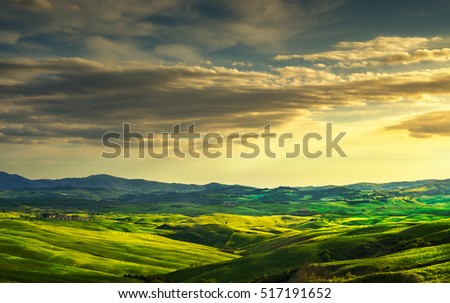 Volterra panorama, rolling hills and green fields on sunset. Rural landscape. Volterra Italy, Europe #517191652