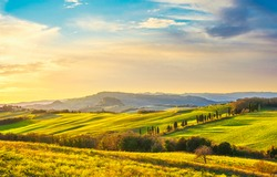 Volterra panorama, rolling hills, green fields and white road. Tuscany, Italy Europe.
