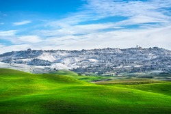 Volterra snowy town and rolling hills in winter. Pisa province, Tuscany, Italy, Europe.